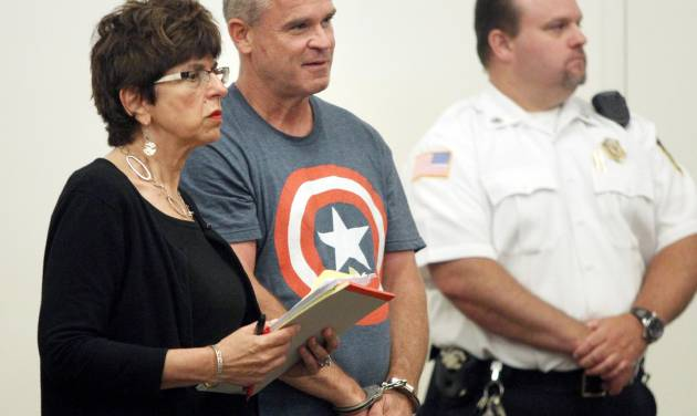 James Lacroix, 53, center, stands during an appearance with defense attorney Penelope Psomos at Barnstable District Court in Barnstable, Mass., Wednesday, July 16, 2014.  Lacroix, accused of breaking into a home on Cape Cod once owned by John F. Kennedy, told authorities he was looking for singer Katy Perry. (AP Photo/Angela Rowlings, The Boston Herald)  BOSTON OUT