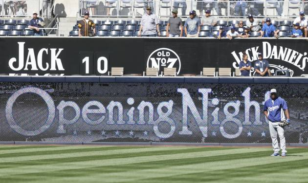 Los Angeles Dodgers right fielder Yasiel Puig stands alone in the outfield during pregame activities before the opening game of Major League baseball in the United States between the Los Angeles Dodgers and San Diego Padres Sunday, March 30, 2014, in San Diego.  (AP Photo/Lenny Ignelzi)