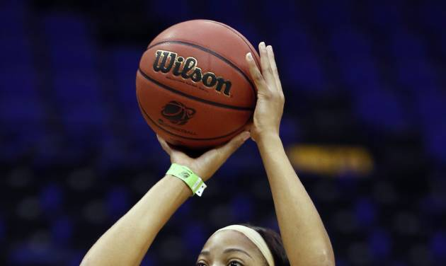 West Virginia center Asya Bussie shoots during practice at the NCAA women's college basketball tournament in Baton Rouge, La., Saturday, March 22, 2014. West Virginia faces Albany (N.Y.) in a first-round game on Sunday. (AP Photo/Rogelio V. Solis)
