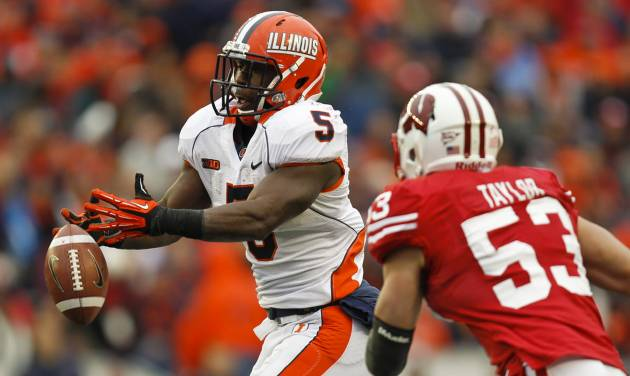 Illinois' Donovonn Young (5) cannot hang on to a pass against Wisconsin linebacker Mike Taylor during the second half of an NCAA college football game on Saturday, Oct. 6, 2012, in Madison, Wis. (AP Photo/Andy Manis)