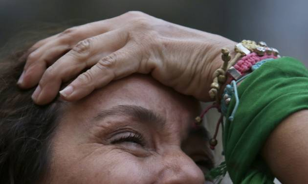 RETRANSMITTING FOR IMPROVED QUALITY.- A Brazil soccer fan cries as she watches Germany defeat her team in a World Cup semifinal match, via a live telecast in Belo Horizonte, Brazil, Tuesday, July 8, 2014. The tears started flowing before half time, and by the end of a 7-1 shellacking in the World Cup semifinal, millions across Brazil were in dazed, damp-eyed disbelief. (AP Photo/Bruno Magalhaes)