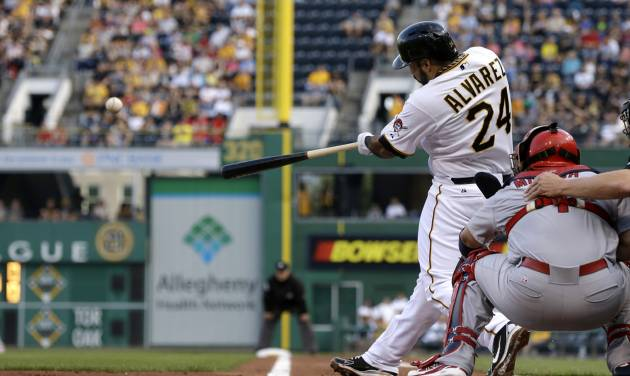 Pittsburgh Pirates' Pedro Alvarez (24) hits a three-run home run off St. Louis Cardinals starting pitcher Jake Westbrook (35) during the first inning of a baseball game in Pittsburgh, Monday, July 29, 2013. (AP Photo/Gene J. Puskar)