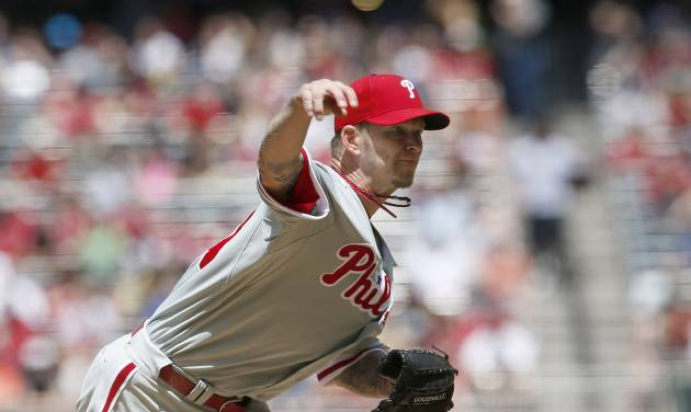Philadelphia Phillies' A.J. Burnett throws a pitch against the Arizona Diamondbacks during the first inning of a baseball game on Sunday, April 27, 2014, in Phoenix. (AP Photo/Ross D. Franklin)