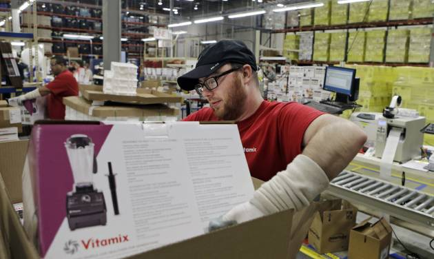 In this April 15, 2014 photo, Charles Rajecky packs a completed blender for warehousing at the Vitamix manufacturing facility in Strongsville, Ohio. The Commerce Department releases durable goods for March on Thursday, April 24, 2014. (AP Photo/Mark Duncan)