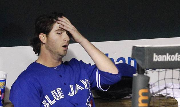 Toronto Blue Jays starting pitcher Drew Hutchison sits in the dugout after leaving the baseball game in the sixth inning against the Baltimore Orioles in Baltimore, Thursday, April 26, 2012. Baltimore won 5-2. (AP Photo/Patrick Semansky)