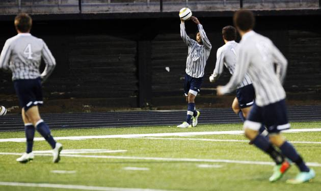 Edmond North's Zac Medawattage (14) throws the ball in to a teammate during a high school soccer game between Edmond North and Midwest City in Midwest City on Tuesday, April 29, 2014. Edmond North defeated Midwest City 10-0.  Photo by KT King, The Oklahoman