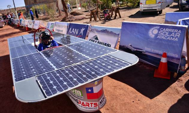 In this photo released by Carrera Solar Atacama 2012, a driver sits in his solar powered car from the team Condor 2 Mining Parts at the start of the first phase of a race, in Humberstone in the area of Pozo Almonte, Chile, Thursday, Nov. 15, 2012. Most participants belong to universities and an entry rule is that cars cannot cost more then $7,000 dollars. (AP Photo/Carrera Solar Atacama 2012)
