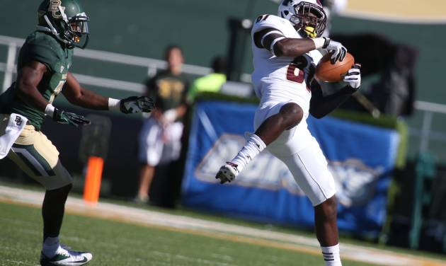 Louisiana-Monroe wide receiver Rashon Ceaser, right, pulls down a pass in front of Baylor safety Terrell Burt during the first half of a NCAA college football game, Saturday, Sept. 21, 2013, in Waco, Texas. (AP Photo/Waco Tribune Herald, Rod Aydelotte)