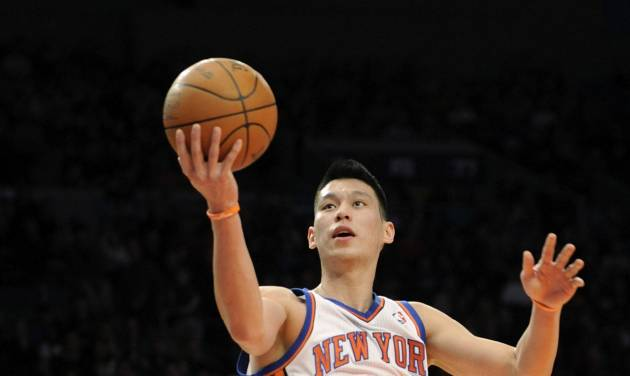 FILE - In this Feb. 4, 2012, file photo, New York Knicks' Jeremy Lin drives to the basket during the second quarter of an NBA basketball game New Jersey Nets at Madison Square Garden in New York. Linsanity could be put to rest in New York when the clock strikes midnight. That's the deadline the Knicks face to match the daunting offer the Houston Rockets have made to Lin, the Harvard point guard who dazzled all of basketball for a brief stretch last season. (AP Photo/Bill Kostroun, File)