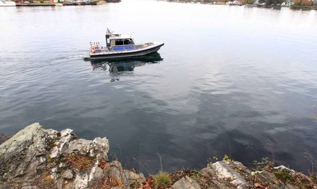 "The New Hampshire Marine Patrol continues to search the Piscataqua River near a cliff on Pierce Island for the body Elizabeth ""Lizzy"" Marriott, a missing University of New Hampshire student on Monday, Oct. 15, 2012 in Portsmouth, N.H. Seth Mazzaglia, a 29-year-old martial arts instructor was held without bail Monday on a charge of strangling or suffocating Marriott, who vanished a week ago. (AP Photo/Jim Cole)"