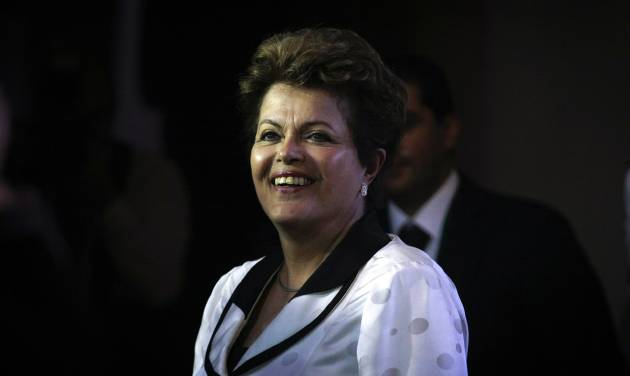 Brazil's President Dilma Rousseff arrives at La Moneda Palace for a work visit in Santiago, Chile, Saturday, Jan. 26, 2013. Leaders from the European Union, Latin America and the Caribbean gather in Santiago for the CELAC-EU economic summit Jan 26-27. (AP Photo/Luis Hidalgo)