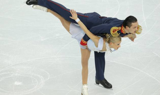 Tatiana Volosozhar and Maxim Trankov of Russia compete in the team pairs short program figure skating competition at the Iceberg Skating Palace during the 2014 Winter Olympics, Thursday, Feb. 6, 2014, in Sochi, Russia. (AP Photo/Vadim Ghirda)