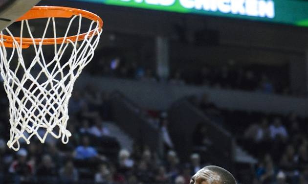Charlotte Bobcats' Kemba Walker (15) is fouled under the basket by Portland Trail Blazers' Meyers Leonard during the first half of an NBA  basketball game in Portland, Ore., Monday, March 4, 2013. (AP Photo/Greg Wahl-Stephens)
