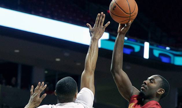 Iowa State's Dustin Hogue, right, shoots over Texas Tech's Jaye Crockett during an NCAA college basketball game in Lubbock, Texas, Saturday, Jan, 4, 2014. (AP Photo/The Avalanche-Journal, Zach Long)