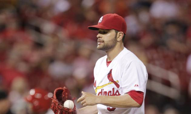 St. Louis Cardinals starting pitcher Jaime Garcia regroups as Philadelphia Phillies' Marlon Byrd circles the bases after hitting a solo home run in the sixth inning of a baseball game, Friday, June 20, 2014, in St. Louis. (AP Photo/Tom Gannam)