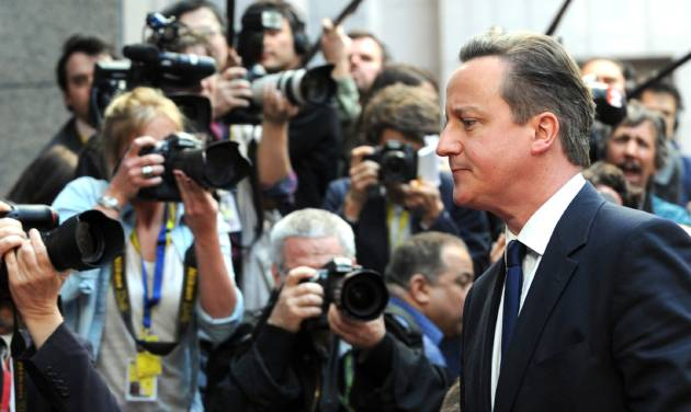 British Prime Minister David Cameron walks by the media as he arrives for an EU summit in Brussels on Thursday, March 20, 2014. The EU Commission president wants a two-day summit of European Union leaders to center on boosting the fledgling government in Kiev rather than focus exclusively on sanctions against Russia over its annexation of Ukraine's Crimea peninsula. (AP Photo/Eric Vidal)