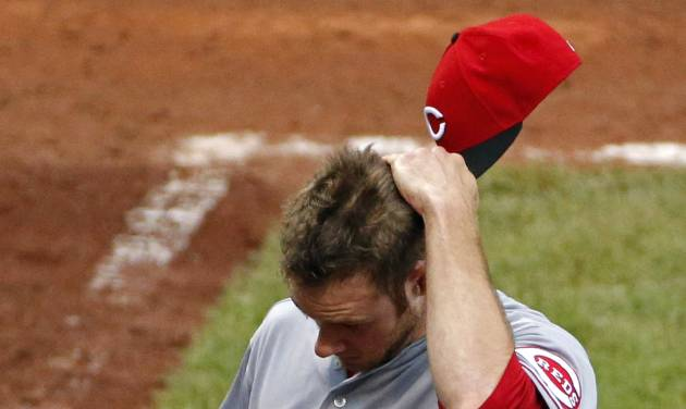 Cincinnati Reds relief pitcher Tony Cingrani (52) walks to the dugout after pitching the 11th inning of a baseball game against the Pittsburgh Pirates in Pittsburgh Thursday, June 19, 2014. The Pirates won 4-3. (AP Photo/Gene J. Puskar)