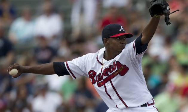 Atlanta Braves pitcher Julio Teheran delivers a pitch during the first inning of an exhibition spring training baseball game against the Houston Astros on Saturday, March 23, 2013, in Kissimmee, Fla.  (AP Photo/Evan Vucci)