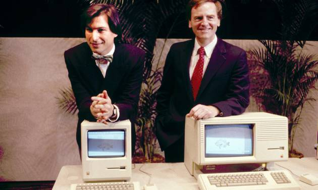 FILE -This January 1984, file photo, shows Steven P. Jobs, left and John Sculley presenting the new Macintosh Desktop Computer in January 1984 at a shareholder meeting in Cupertino, Calif. January 24, 2014, marks thirty years after the first Mac computer was introduced, sparking a revolution in computing and in publishing as people began creating fancy newsletters, brochures and other publications from their desktops. (AP Photo/FILE)