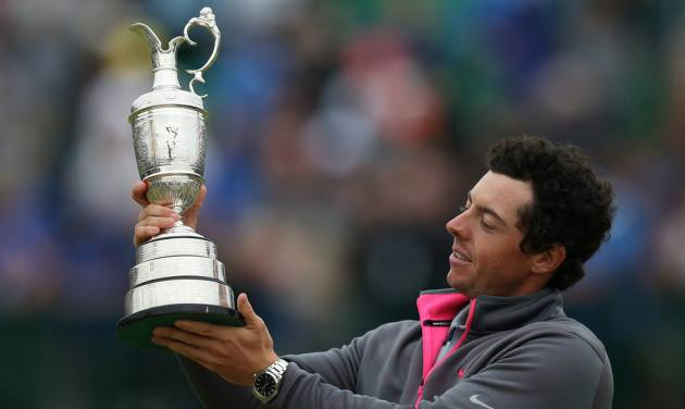Rory McIlroy of Northern Ireland holds up the Claret Jug trophy after winning the British Open Golf championship at the Royal Liverpool golf club, Hoylake, England, Sunday July 20, 2014. (AP Photo/Scott Heppell)
