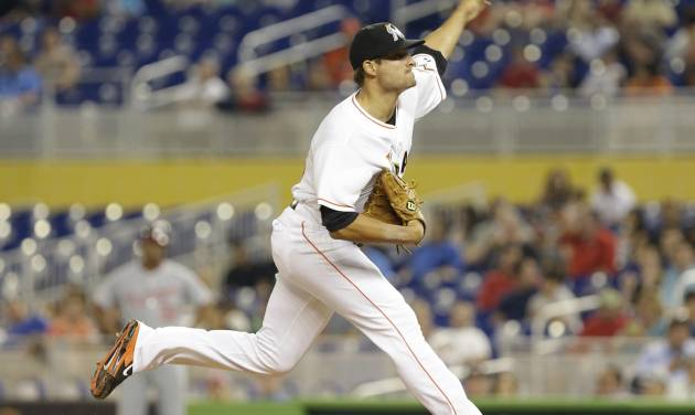 Miami Marlins starting pitcher Brad Hand throws during the first inning of the MLB National League  baseball game against the Washington Nationals, Monday, April 14, 2014, in Miami. (AP Photo/Lynne Sladky)