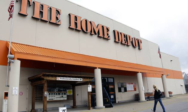 FILE - In this Aug. 14, 2012, file photo, a person walks toward a Home Depot in Nashville, Tenn. Home Depot Inc. reports quarterly financial results before the market opens on Tuesday, Feb. 25, 2014. (AP Photo/Mark Humphrey, File)