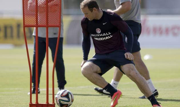 England national soccer team player Wayne Rooney takes part in a squad training session for the 2014 soccer World Cup at the Urca military base in Rio de Janeiro, Brazil, Monday, June 16, 2014.  (AP Photo/Matt Dunham)