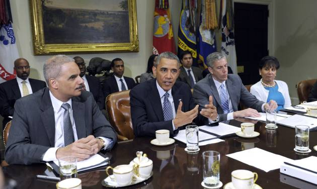 "President Barack Obama, flanked by Attorney Holder Eric Holder, left, and Housing and Urban Development Secretary Shaun Donovan, left, speaks about a report from ""My Brother's Keeper,"" an initiative to expand opportunity for young men and boys of color, Friday, May 30, 2014, during a meeting in the Roosevelt Room of the White House in Washington. (AP Photo/Susan Walsh)"