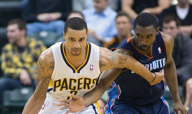 Indiana Pacers' George Hill (3) drives against Charlotte Bobcats' Ben Gordon (8) during the second half of an NBA basketball game in Indianapolis, Saturday, Jan. 12, 2013. The Pacers defeated the Bobcats 96-88. (AP Photo/Doug McSchooler)