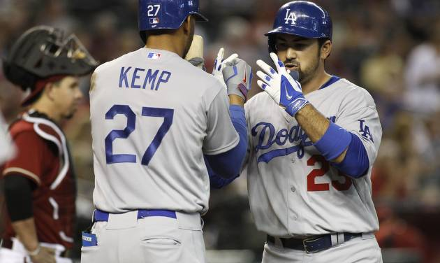Los Angeles Dodgers' Adrian Gonzalez, right, is greeted at home plate by teammate Matt Kemp (27) after hitting a three-run home run against the Arizona Diamondbacks during the third inning of a baseball game on Sunday, April 13, 2014, in Phoenix. (AP Photo/Ralph Freso)