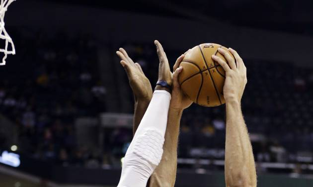 New Orleans Hornets' Robin Lopez, right, has his shot blocked by Indiana Pacers' Roy Hibbert during the first half of an NBA basketball game, Wednesday, Nov. 21, 2012, in Indianapolis. (AP Photo/Darron Cummings)
