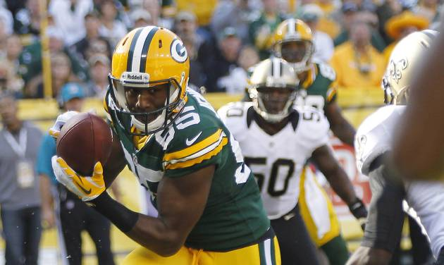 Green Bay Packers wide receiver Greg Jennings catches a touchdown pass in front of New Orleans Saints free safety Isa Abdul-Quddus, right, during the first half of an NFL football game Sunday, Sept. 30, 2012, in Green Bay, Wis. (AP Photo/Mike Roemer)