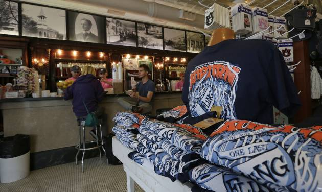 """One Last Fling"" t-shirts are displayed for sale at Toomer's Drugs in Auburn, Ala., Friday, April 19, 2013. The tradition of ""rolling"" the trees at Toomer's Corner following a win by the football team is coming to an end with one final celebration involving the poisoned oaks. Auburn fans will roll the trees Saturday following the spring football game and officials will take down the dying trees down on Tuesday. (AP Photo/Dave Martin)"