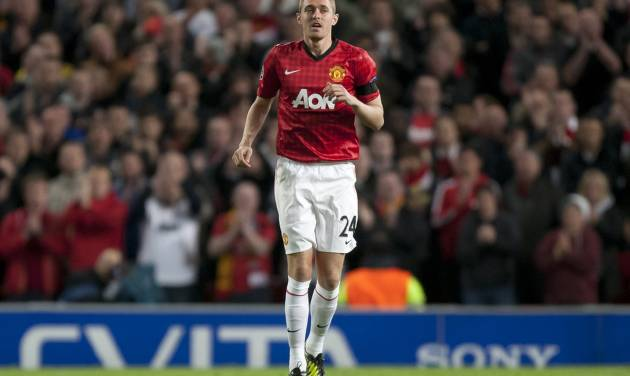 Manchester United's Darren Fletcher takes to the pitch during his team's 1-0 win over Galatasaray in their Champions Graoup H soccer match at Old Trafford Stadium, Manchester, England, Wednesday, Sept. 19, 2012. (AP Photo/Jon Super)