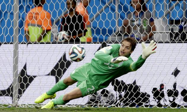 Netherlands' goalkeeper Tim Krul saves a penalty kick during the World Cup quarterfinal soccer match between the Netherlands and Costa Rica at the Arena Fonte Nova in Salvador, Brazil, Saturday, July 5, 2014. The Netherlands won 4-3 on penalty kicks. (AP Photo/Hassan Ammar)