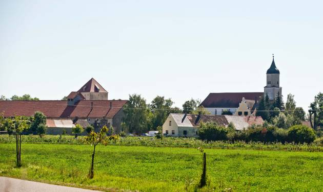 """This picture taken Thursday, Sept. 5, shows the village of Klosterzimmern near Deiningen, Germany, which is one of the homes of the """"Twelve Tribes"""" sect. Police say they have raided the Christian religious sect in Bavaria and taken 40 children from them on allegations that they were being physically abused. Bavarian police said Friday, Sept. 6, 2013, that the children of the sect were taken into protective custody the day before as investigators look into allegations that they were being beaten and otherwise physically punished. Authorities say 28 of the children were found at one of the sect's locations in the town of Deinigen, and 12 others in Woernitz. (AP Photo/dpa, Daniel Karmann)"""
