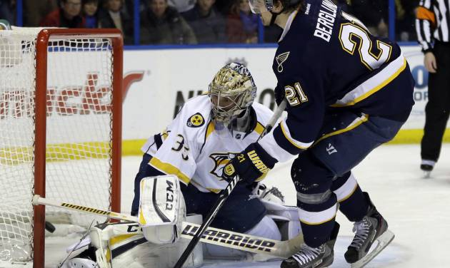 St. Louis Blues' Patrik Berglund, right, of Sweden, scores on a penalty shot past Nashville Predators goalie Pekka Rinne, left, of Finland, during the second period of an NHL hockey game on Thursday, Jan. 24, 2013, in St. Louis. (AP Photo/Jeff Roberson)