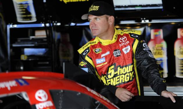 Driver Clint Bowyer looks on from the garage area before practice for the AAA 400 NASCAR Sprint Cup Series auto race, Friday, Sept. 28, 2012, in Dover, Del. (AP Photo/Nick Wass)