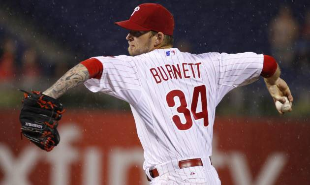 Philadelphia Phillies starting pitcher A.J. Burnett pitches in the rain during the sixth inning of a baseball game against the San Francisco Giants, Wednesday, July 23, 2014, in Philadelphia. (AP Photo/Chris Szagola)