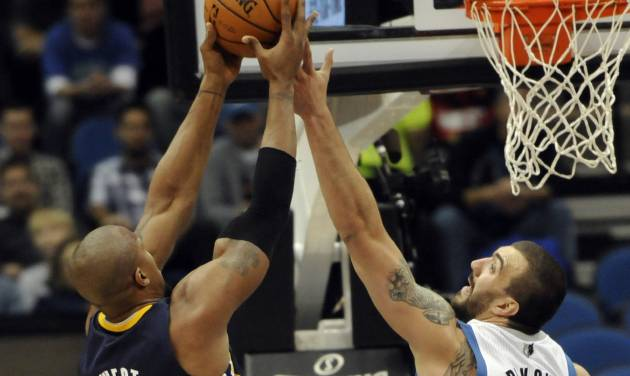 Indiana Pacers' David West, left, beats Minnesota Timberwolves' Nikola Pekovic of Montenegro to the rebound in the first half of an NBA basketball game, Friday, Nov. 9, 2012, in Minneapolis. (AP Photo/Jim Mone)
