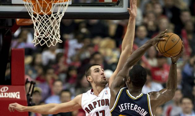 Toronto Raptors center Jonas Valanciunas (17) defends against Utah Jazz center Al Jefferson (25) during the first half of an NBA basketball game in Toronto on Monday, Nov. 12, 2012. (AP Photo/The Canadian Press, Frank Gunn)
