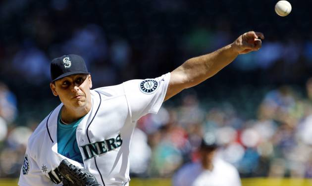 Seattle Mariners starting pitcher Jason Vargas throws against the Boston Red Sox in the second inning of a baseball game, Monday, Sept. 3, 2012, in Seattle. (AP Photo/Elaine Thompson)