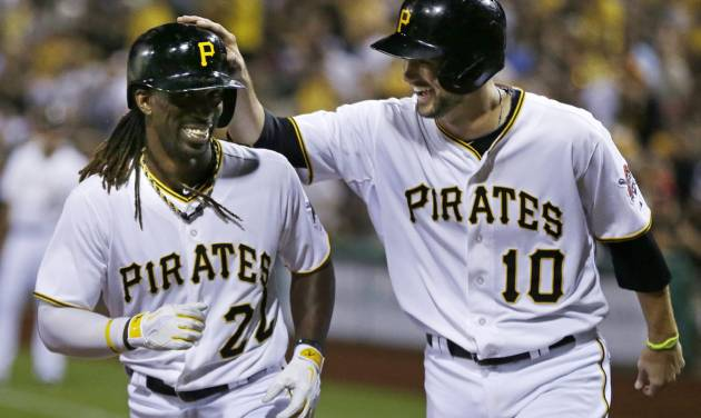 ADVANCE FOR WEEKEND EDITIONS, AUG. 31 - SEPT. 1 - FILE - In this July 30, 2013 file photo, Pittsburgh Pirates' Andrew McCutchen (22) celebrates with teammate Jordy Mercer (10) after hitting a two-run home run off St. Louis Cardinals starting pitcher Tyler Lyons during the fifth inning of the second baseball game of a doubleheader in Pittsburgh. The Pirates run of 20 consecutive losing seasons is the longest in North American professional sports history, but the end is just a formality, and these resurgent Pirates are now focused on a postseason berth and beyond. (AP Photo/Gene J. Puskar, File) ORG XMIT: NY196
