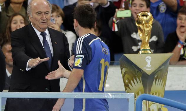 Argentina's Lionel Messi shakes hands with FIFA President Sepp Blatter after the World Cup final soccer match between Germany and Argentina at the Maracana Stadium in Rio de Janeiro, Brazil, Sunday, July 13, 2014. Germany won the match 1-0. (AP Photo/Matthias Schrader)