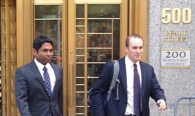 Rengan Rajaratnam, left, exits Manhattan federal court in New York with his attorney Daniel Gitner Tuesday, July 8, 2014 after he was acquitted of conspiracy to commit securities fraud. Prosecutors had alleged that Rajaratnam, 43, joined with his brother, Raj Rajaratnam, to cheat in the stock market in 2008 on the securities of two technology companies. (AP Photo/Larry Neumeister)