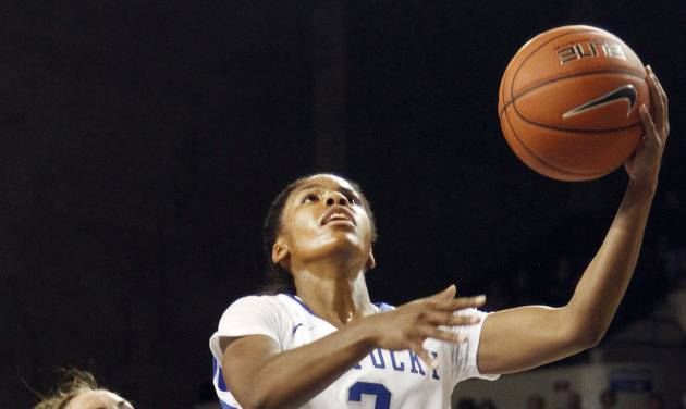 Kentucky's Janee Thompson (3) shoots next to Central Michigan's Niki DiGuilio (24) during the second half of an NCAA college basketball game on Sunday, Nov. 17, 2013, in Lexington, Ky. (AP Photo/James Crisp)