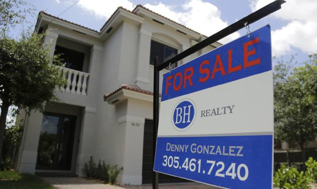 This Monday, May 19, 2014 photo shows a duplex home for sale in the Coconut Grove neighborhood in Miami. The National Association of Realtors reports on existing-home sales in April on Thursday, May 22, 2014. (AP Photo/Lynne Sladky)