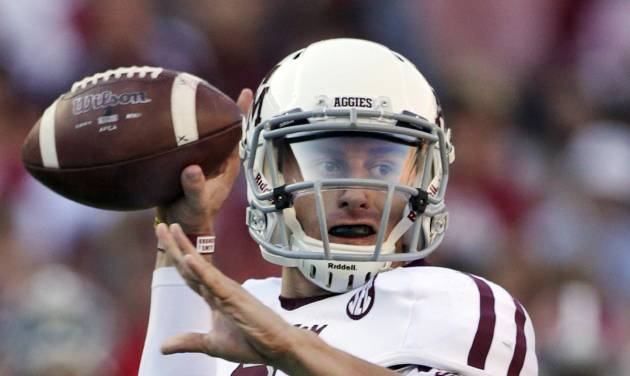 FILE - In this Nov. 10, 2012, file photo, Texas A&M quarterback Johnny Manziel (2) looks for a receiver during the first half of an NCAA college football game against Alabama at Bryant-Denny Stadium in Tuscaloosa, Ala. Manziel was selected to the first-team on The Associated Press All-America football team released Tuesday, Dec. 11, 2012.(AP Photo/Dave Martin, File)