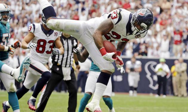 Houston Texans running back Arian Foster (23) leaps into the end zone for a touchdown against the Miami Dolphins in the second quarter of an NFL football game, Sunday, Sept. 9, 2012, in Houston. (AP Photo/Eric Gay)