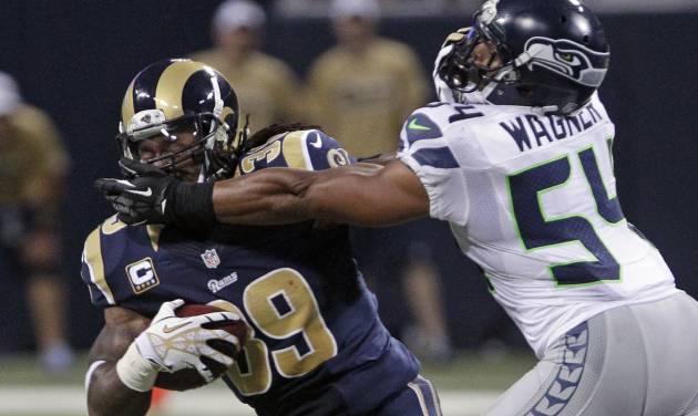 St. Louis Rams running back Steven Jackson is tackled by Seattle Seahawks middle linebacker Bobby Wagner during the second half of an NFL football game Sunday, Sept. 30, 2012, in St. Louis. (AP Photo/Seth Perlman)